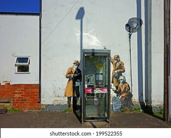 Cheltenham UK, April 16, 2014 : Street Art on wall in Cheltenham, possibly Banksy GCHQ theme
