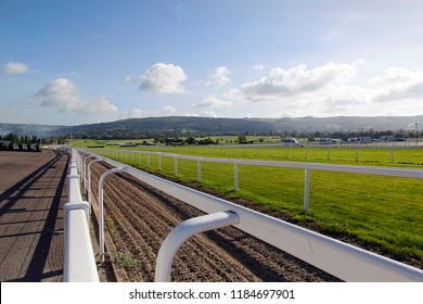 Cheltenham, UK: September 15, 2018: Cheltenham Racecourse in the early morning looking at the training course of the race horses over the safety barriers.