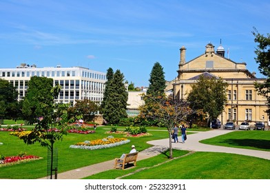 CHELTENHAM, UK - SEPTEMBER 8, 2014 - Flowerbeds in the Imperial Gardens with the town hall on the right hand side, Cheltenham, Gloucestershire, England, UK, Western Europe, September 8, 2014.