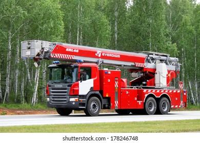 CHELYABINSK REGION, RUSSIA - AUGUST 14, 2009: Red Scania P380 fire ladder at the interurban road.