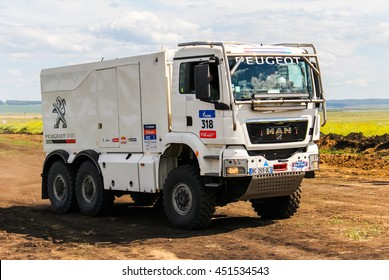 CHELYABINSK REGION, RUSSIA - JULY 11, 2016: Sports truck MAN TGS of the Team Peugeot Total No. 318 competes in the annual Rally Silkway - Dakar Series.