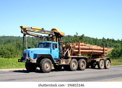 CHELYABINSK REGION, RUSSIA - JULY 20, 2008: Cyan Ural 4320 timber lorry at the interurban road.