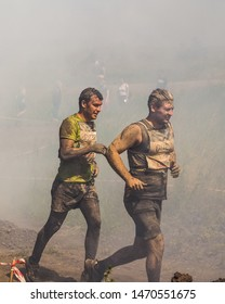 "CHELYABINSK, Russia - 24 June 2019: obstacle race called ""race of heroes"". endurance competition with the overcoming of running hills, mud, water and sports military obstacles."