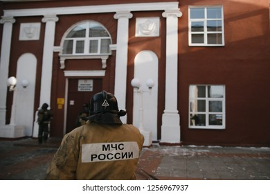 CHELYABINSK, RUSSIA, December 11, 2018: Group of firefighters advance forward putting out a fire. MCHS rescuers on fire extinguishing exercises
