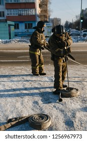 CHELYABINSK, RUSSIA, December 11, 2018: fire service workers twist the fire hose. MCHS RUSSIA Rescue Service staff at the exercise