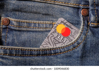 CHELYABINSK, RUSSIA - December 2017: Plastic credit card Mastercard in jeans pocket.