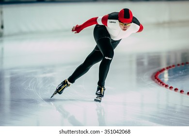 Chelyabinsk; Russia - December 3; 2015: closeup young woman athlete speedskater goes around turn of rink during Cup of Russia on speed skating