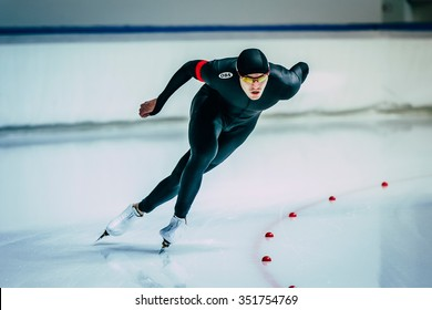 Chelyabinsk; Russia - December 3; 2015: male skater during race sprint distance along path of ice Palace during Cup of Russia on speed skating