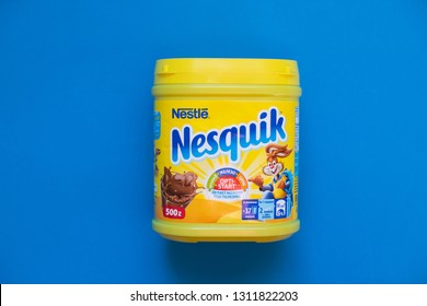 Chelyabinsk, Russia - February 12, 2019:  Pack of chocolate and cacao drink Nesquik by Nestle on blue background