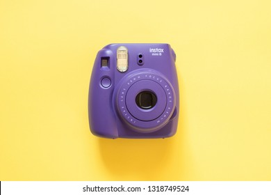 Chelyabinsk, Russia - February 15, 2019: Fujifilm instax mini camera on yellow background