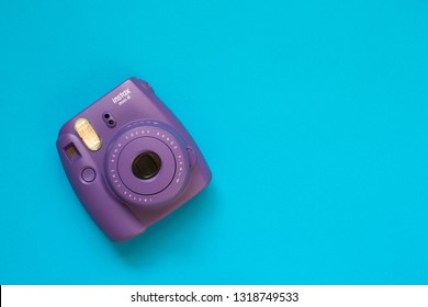Chelyabinsk, Russia - February 15, 2019: Fujifilm instax mini camera on blue background