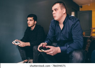 CHELYABINSK, RUSSIA, FEBRUARY 23, 2017: A young people holding and playing Sony Dualshock controller for the PlayStation, a video game console.