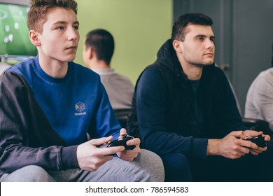 CHELYABINSK, RUSSIA, FEBRUARY 23, 2017: A young people holding and playing a game controller for the Microsoft Xbox, a video game console.