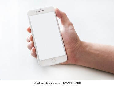 Chelyabinsk, Russia, February 3, 2018: High detailed Realistic smartphone in man hand. White Iphone 8 plus mock up.