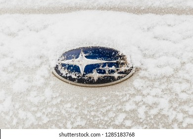 Chelyabinsk, Russia - January 14, 2019: Car operation Subaru in winter, the Ural winter and a lot of snow. Snow covered Subaru company logo