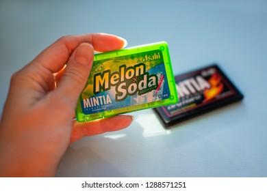 Chelyabinsk, Russia - January 18, 2019: Hand hold Mintia - Melon soda Sugarless Mints produced in Japan by brand Asahi