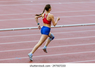 Chelyabinsk, Russia - July 10, 2015: girl athlete runs 400 meters during Championship of Chelyabinsk on track and field athletics, Chelyabinsk, Russia - July 10, 2015