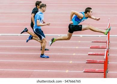 Chelyabinsk, Russia - July 10, 2015: man athletes run 110 meter hurdles during Championship of Chelyabinsk on track and field athletics