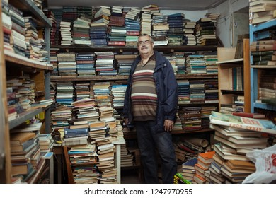 Chelyabinsk Russia - July 21, 2014: Second-hand bookseller Mikhail Smolin sells old books in a second-hand shop on Lenin Avenue