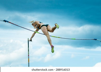 Chelyabinsk, Russia - June 10, 2015: female athlete competing in pole vault during universities championship of Chelyabinsk region in athletics