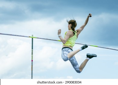 Chelyabinsk, Russia - June 10, 2015: young girl athlete performs successful attempt pole vault during universities championship of Chelyabinsk region in athletics