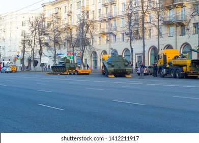 Chelyabinsk, Russia - May 2019: Transportation of heavy armored vehicles along Lenin Avenue. T-34 stands on the trawl. IS-2 under the supervision of specialists calls in on the trawl. Parade rehearsal