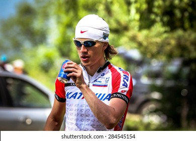 "Chelyabinsk, Russia - may 31, 2015: young male cyclist drinking a carbonated beverage of the race ""New Energy 2015"""