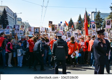 "CHELYABINSK , RUSSIA / MAY 9 , 2016 : People participate in the action ""Immortal regiment"" on the parade dedicated to the celebration of the Victory may 9, 1945"