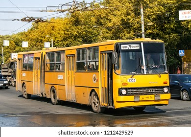 Chelyabinsk, Russia - September 18, 2009: Yellow articulated bus Ikarus 280 in the city street.