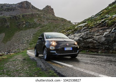 CHELYABINSK, Russia - September 20, 2016: Black car FIAT 500 standing on the road near mountains at daytime. Italian Alps.
