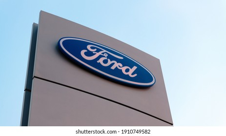 Chelyabinsk, Russia - September 29, 2020: Ford  Company brand logo on the stand against the blue sky. Ford is a representative of the American auto brand