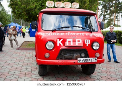 Chelyabinsk Russia - September 7, 2014: The propaganda bus of the red color of the Communist Party of Russia with the inscription: Communist Party of the Russian Federation