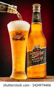 Chelyabinsk, Russian Federation - June 15, 2019: Miller beer bottle and frosty glass full of beer with foam. Miller Genuine Draft is a product of the Miller brewery owned by SABMiller. Editorial use