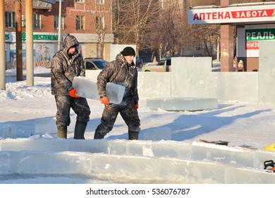 CHELYABINSK,RUSSIA - DECEMBER 14,2016: Workers build ice town out of blocks.
