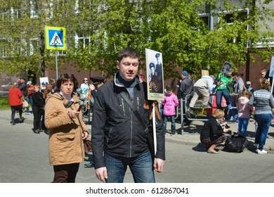 "CHELYABINSK,RUSSIA - MAY 9,2016:People participate in the action ""Immortal regiment"" on the parade dedicated to the celebration of the Victory may 9, 1945"