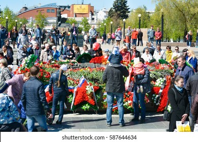 CHELYABINSK,RUSSIA - MAY 9,2016:the Eternal flame and flowers dedicated to the unknown soldier in the victory on 9 may 1945 .The people remember the war dead.