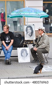 CHELYABINSK,RUSSIA - SEPTEMBER 4,2010:Male artist with paintings at the city festival
