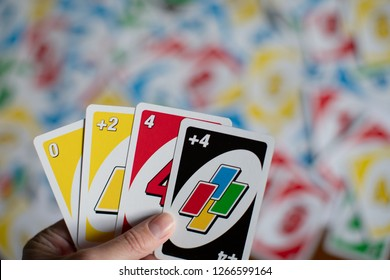Chelybinsk, Russia - December 25, 2018: Playing american card game Uno, holding game cards in female hand.