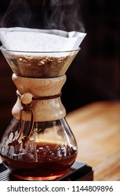 chemex with hot coffee. close up portrait.chemex containing brewed joe