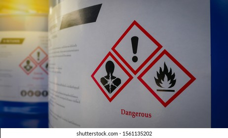 Chemical Barrels Tank with a warning label in Chemical factory