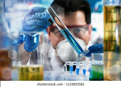 chemical engineer holding test tube with chemist material in the investigation lab / researcher working with tube test in the research laboratory