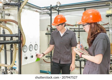 Chemical engineer open  valve equipment in a boiler house