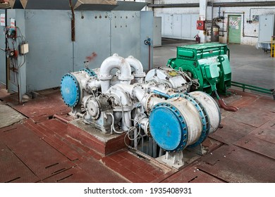 Chemical enterprise interior with equipment. Oxygen compressor for supplying workshops and departments of chemical plant with oxygen, for further petrochemical synthesis and reactions.