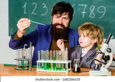 Chemical experiment. Genius minds. Signs your child could be gifted. Special and unique. Genius toddler private lesson. Genius kid. Joys and challenges raising gifted child. Teacher child test tubes.