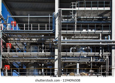 Chemical factory. Elastomer and thermoplastic production line. Polymerization vats and steel pipeline for delivering components.