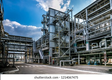 Chemical factory. Elastomer and thermoplastic production line. Vats for preparing monomers and polymerization and steel pipeline for delivering components.