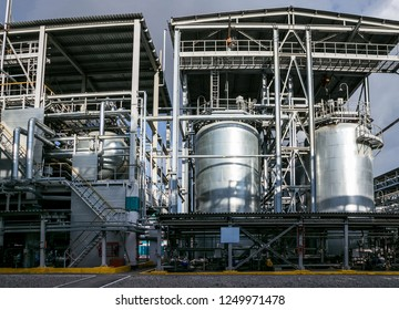 Chemical factory. Elastomer and thermoplastic production line. Large vats for preparing monomers and polymerization.