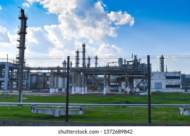 Chemical factory. Elastomer and thermoplastic production line. Vats for preparing monomers and polymerization and steel pipeline for delivering components. Industrial area near the petrochemical plant