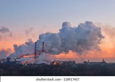 Chemical factory in the morning, with pipes and smoke, long exposure