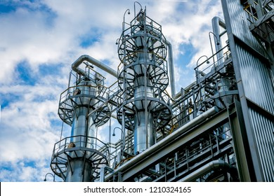 Chemical factory. Rectification towers, close up view